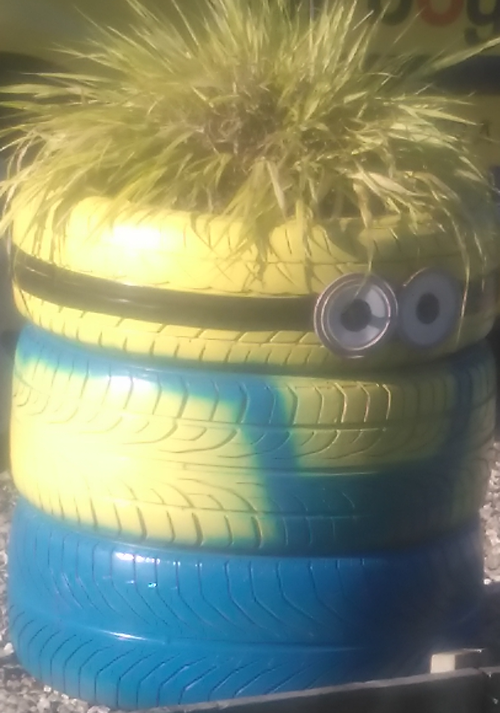 Tyres stacked, painted and dressed as a minion